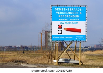 Almere Poort, Flevoland, The Netherlands - March 9, 2018: Billboard for the Dutch elections of the municipal council or local government and referendum on 21 march 2018.