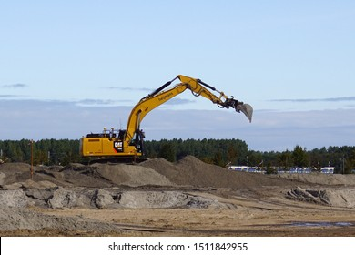 Almere Poort, the Netherland - September 20, 2019:  Caterpillar CAT 330 f Hydraulic Crawler Excavator working at a sandy Dutch construction site.