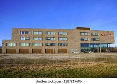 Almere Poort, the Netherlands - Januari 18, 2019: Building of middle-level applied education, ROC Flevoland, MBO College Poort, against a clear blue sky.