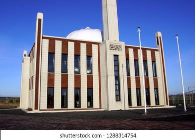 Almere Poort, the Netherlands - Januari 18, 2019: Bait-ul-Afiyat mosque against a clear blue sky.