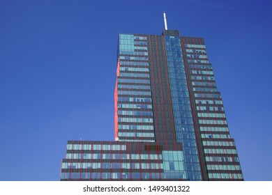 Almere Stad, the Netherlands - September 1, 2019: World Trade Center Almere against a clear blue sky.