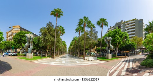 "Almeria, Andalusia / Spain - September 15, 2019: Candle Square (Plaza de las Velas –sp) near the sign ""I love Almeria"", which welcomes visitors to the city. Panorama"