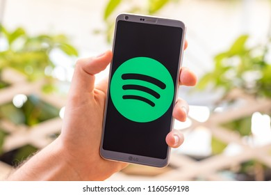 Almeria, Spain - August 18, 2018: Holding a LG G6 Android smartphone on hand with Spotify logo on screen