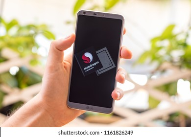 Almeria, Spain - August 18, 2018: Holding a LG G6 Android smartphone on hand with Qualcomm Snapdragon processor on screen