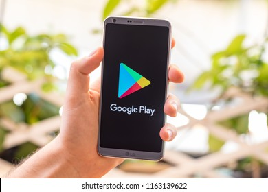 Almeria, Spain - August 18, 2018: Holding a LG G6 Android smartphone on hand with Google Play logo on screen