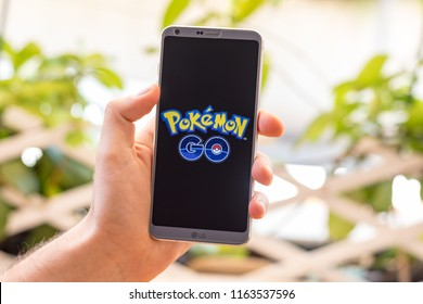 Almeria, Spain - August 18, 2018: Holding a LG G6 Android smartphone on hand with Pokémon Go logo on screen