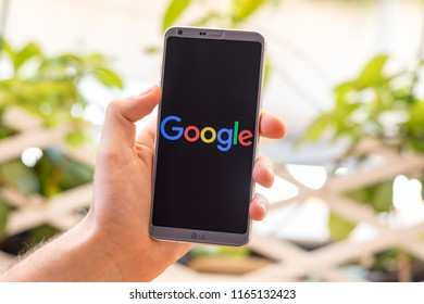 Almeria, Spain - August 18, 2018: Holding a LG G6 Android smartphone on hand with Google logo on screen