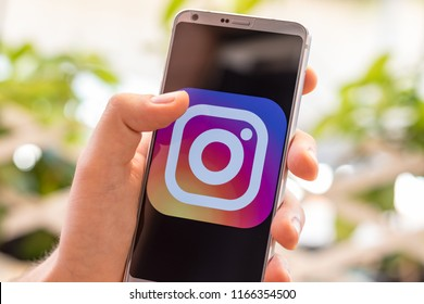 Almeria, Spain - August 18, 2018: Holding a LG G6 Android smartphone on hand with Instagram logo on screen