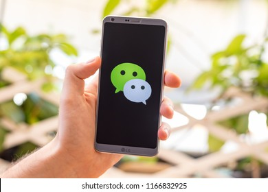 Almeria, Spain - August 18, 2018: Holding a LG G6 Android smartphone on hand with WeChat logo on screen