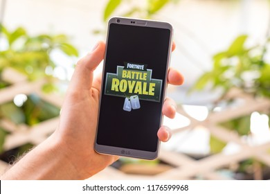 Almeria, Spain - August 18, 2018: Holding a LG G6 Android smartphone on hand with Fortnite Battle Royale logo on screen