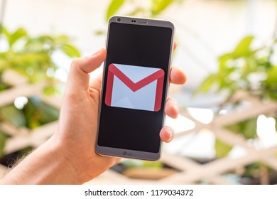 Almeria, Spain - August 18, 2018: Holding a LG G6 Android smartphone on hand with Gmail logo on screen
