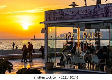 Almeria, Spain. Circa February 2019. Locals and tourists enjoy the sunset from El Zapillo promenade, packed with cafes and restaurants such as popular Cafe Paris.