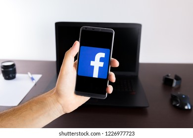 Almeria, Spain - November 11, 2018: Holding a LG G6 Android smartphone on hand with Facebook logo on screen