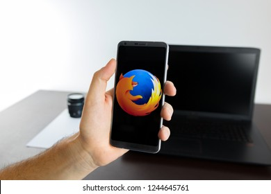 Almeria, Spain - November 11, 2018: Holding a LG G6 Android smartphone on hand with a Mozilla Firefox PNG logo image on screen opened from the Gallery app on the phone covering the whole front display