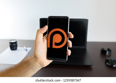 Almeria, Spain - November 11, 2018: Holding a LG G6 Android smartphone on hand with a Pinterest PNG logo image on screen opened from the Gallery app on the phone covering the whole front display