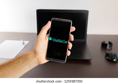 Almeria, Spain - November 11, 2018: Holding a LG G6 Android smartphone on hand with a BlaBlaCar PNG logo image on screen opened from the Gallery app on the phone covering the whole front display
