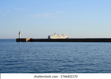 ALMERIA, SPAIN - OCTOBER 25, 2010: MS Nieuw Amsterdam cruise ship leaving the port of Almeria.