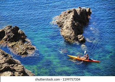 Almeria, Spain- September 22, 2018: People practicing canoeing in summer on the Sirens Reef in Cabo de Gata, Almeria, Spain