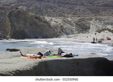 ALMERIA,ES - CIRCA JULY 2008 - Tourists sunbathing on the wild coastline of Cabo the Gata,Spain. Cabo the Gata is a natural reserve and a favourite resort for naturists.