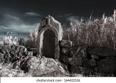 """Alminhas"" (small shrines) are popular representations of the souls in Purgatory... This small granite shrine is located in the rural surroundings of Vila do Conde, Portugal. Used infrared filter."
