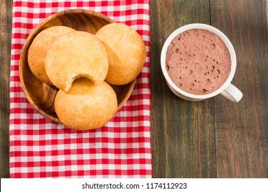 Almojabana, traditional Colombian food - Drink of chocolate