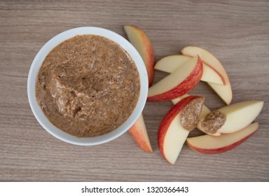 Almond Butter in Small White Bowl and Apple Slices for Snacking