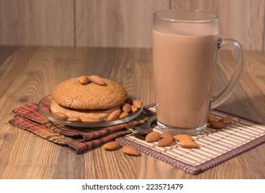 almond cake, almonds and a mug with milk chocolate