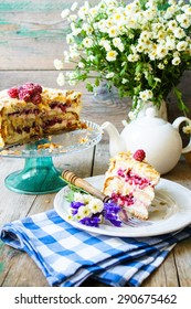 almond cake with Raspberries on the plate and summertime flowers