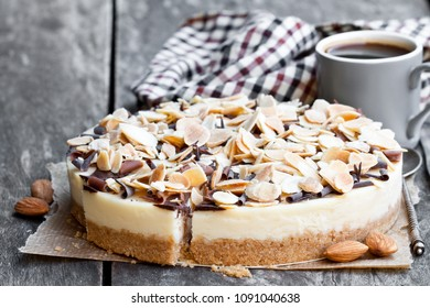 Almond  cheesecake with chocolate flakes on wooden table