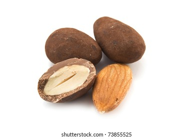 almond is in a chocolate on white background