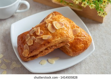 Almond danish pastry on white plate
