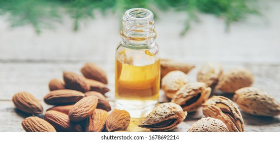 Almond essential oil in a small bottle. Selective focus. nature.