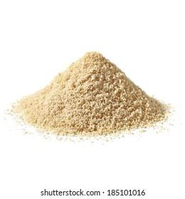 Almond flour pile on white background