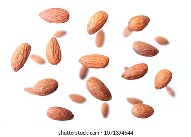 Almond flying on white background.