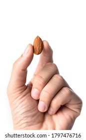 Almond in hand isolated on white background. Almond nuts