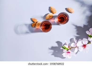 almond liquor. The traditional strong drink in italy to complete the dinner is a liqueur made from nuts and berries. Ratafia, alcohol in shot. top view on the table. Copy space. luce forte