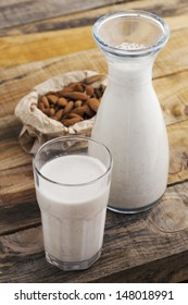 Almond milk. Healthy blended almond on wooden table. Studio shot at daylight, shallow depth of field.