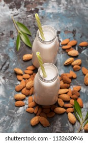 Almond milk and nuts leafs. Natural organic vegetarian drink