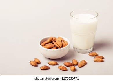 Almond non diary milk and nuts. Health care and diet concept.