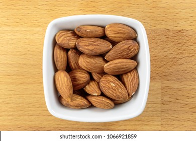 Almond nuts, a healthy and organic food good source of minerals and vitamins, in a white bowl