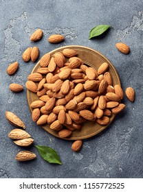 Almond nuts on gray concrete background. Top view.