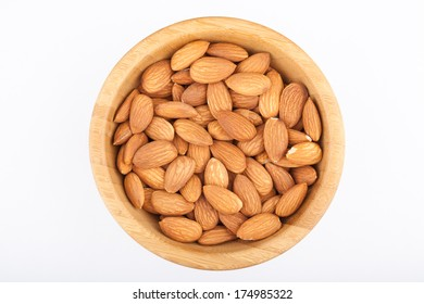 Almond nuts in wooden bowl isolated