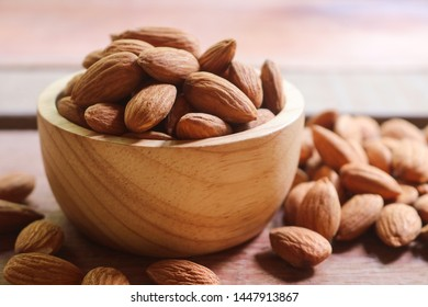 Almond nuts in wooden bowl on rustic background. Almonds are healthiest nuts and one of the best brain foods.