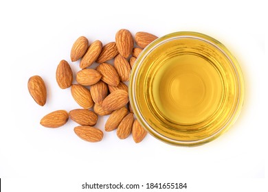 Almond oil and almonds nuts isolated on white background. Top view. Flat lay.