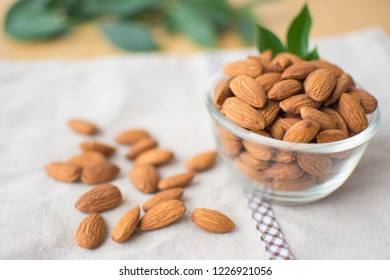 almond on wooden table. soft focus.