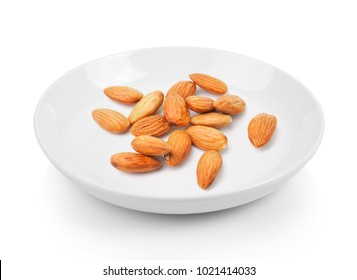 almond in plate on white background