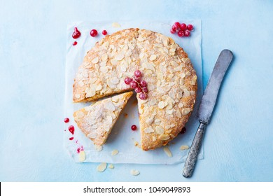 Almond and raspberry cake, Bakewell tart. Traditional British pastry. Top view. Copy space. Blue background.