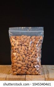 Almond in a zipper bag on wood table.