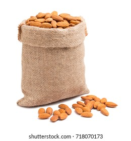 Almonds in bag from sacking isolated on white background
