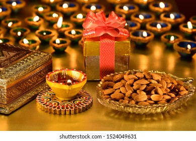 Almonds with beautiful festival background, Diwali lamp & Gift,  Diwali festival Background